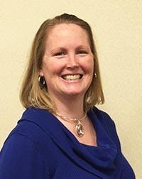 Erin Hauck, Commissioner